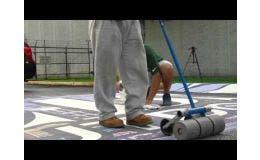 Rolling the Asphalt Art® Graphic After Application